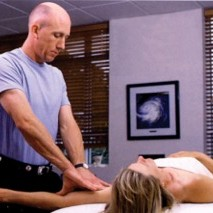 Kyle C. Wright performing therapy on client — clinical / medical massage school in Jacksonville, Florida