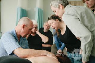 Kyle Wright demonstrating techniques: new massage school classes jacksonville